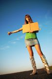 Cool hitch hiking. Girl hitch hiking with blank tablet royalty free stock photography