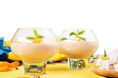 Cool ice cream in dessert glasses isolated on a white background. Cocktails next to Turkish delight and dried apricots. Stock Image