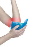Cool ice on a swollen hurting elbow. Stock Image