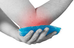 Cool ice on a swollen hurting elbow. Royalty Free Stock Photo