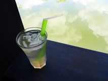 Cool iced lemongrass drink beside resort garden po Stock Image