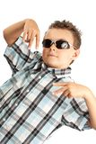 Cool kid. Cool and trendy kid with sunglasses isolated over white background Royalty Free Stock Images