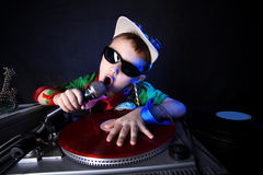 Cool kid DJ in action. Against black Royalty Free Stock Photos