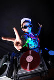 Cool kid DJ in action. With sunglasses Stock Images
