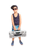 Cool kid in hip-hop clothes holding a radio Stock Photos