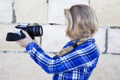 Cool kid holding a camera taking a photo of herself Royalty Free Stock Images
