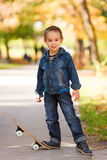 Cool kid playing in park Stock Photography