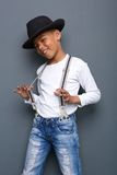 Cool kid smiling with hat and suspenders Royalty Free Stock Images