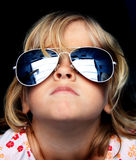 Cool kid with sunglasses. Close up of a young child wearing funky reflective sunglasses Stock Photos