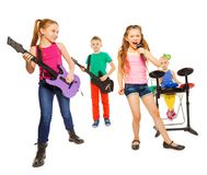 Cool kids play musical instruments as rock group. Cool kids playing on musical instruments as rock group and girl singing as vocalist in front on white Stock Photography