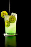 Cool kiwi. A designer cocktail being poured Royalty Free Stock Image
