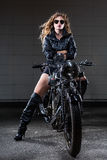 Cool Lady BB148226. This is an image of a beautiful blond woman on an old motorcycle Royalty Free Stock Photo
