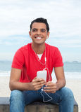 Cool latin guy in red shirt making selfie with phone Royalty Free Stock Photo