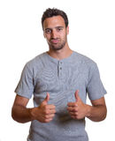 Cool latin guy showing both thumbs Royalty Free Stock Images
