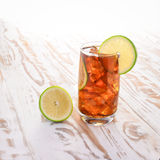 Cool  lemon tea Drink With Lemon and Ice cube on wooden table. Stock Image
