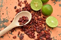 Cool limes and spicy hot dried red chili peppers Stock Photo
