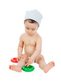 Cool little baby sitting on the floor playing with toys Royalty Free Stock Images