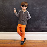 Cool little boy gesturing victory sign Stock Images