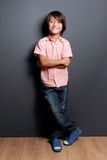 Cool little boy posing with arm crossed Royalty Free Stock Photography