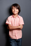 Cool little boy posing with arm crossed Royalty Free Stock Image