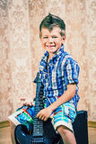 Cool little boy posing with electric guitar. Stock Photography