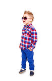 Cool little boy posing on a white background Royalty Free Stock Image