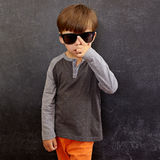 Cool little boy wearing sunglasses Stock Images