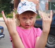 Cool little girl with fingers up in summer. Outdoor Royalty Free Stock Photography