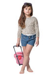 Cool little girl holding baby pink suitcase Stock Images