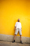 Cool looking bearded guy on yellow wall Royalty Free Stock Photography
