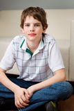 Cool looking boy. Is sitting on the floor Stock Images