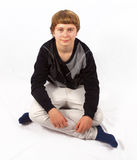 Cool looking boy sitting on the floor Stock Image