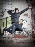 Cool looking dancer posing on a grunge background stock images