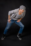 Cool looking dancer posing on a grunge grey wall Royalty Free Stock Photo