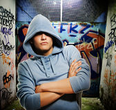 Cool looking hooligan. In a graffiti painted gateway Royalty Free Stock Image