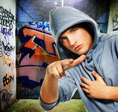 Cool looking hooligan. In a graffiti painted gateway Stock Photography