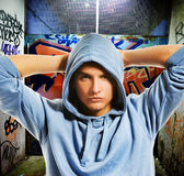 Cool looking hooligan. In a graffiti painted gateway Royalty Free Stock Photo