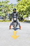 Cool looking motorcycle rider on custom made scrambler style caf Stock Photos