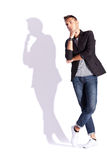 Cool looking shadow of a young casual man Royalty Free Stock Photos