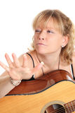 Cool looking woman with acoustic guitar Royalty Free Stock Photos