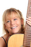 Cool looking woman with acoustic guitar Stock Photography