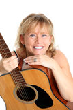 Cool looking woman with acoustic guitar Stock Images