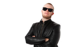 Cool macho man with sunglasses. Macho man wearing a black leather jacket and black sunglasses. White background Stock Images