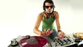 Cool male dj. A cool male dj on the turntables stock video