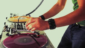 Cool male dj. A cool male dj on the turntables stock footage