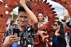 Cool male hipster taking smartphone selfie with beautiful gay street dancer. San Pablo City, Laguna, Philippines - January 13, 2018: Cool young male hipster Royalty Free Stock Photos