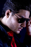 Cool male model with sunglasses. Handsome male model with stubble in a close-up with cool sunglasses Stock Photography