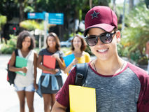 Cool male student with group of international students. Outdoor in the city in the summer Stock Photography