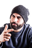 Cool. A man with a beanie and a beard pointing at you isolated over white stock photography