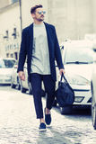 Cool man beautiful model outdoors, city style fashion Royalty Free Stock Photography
